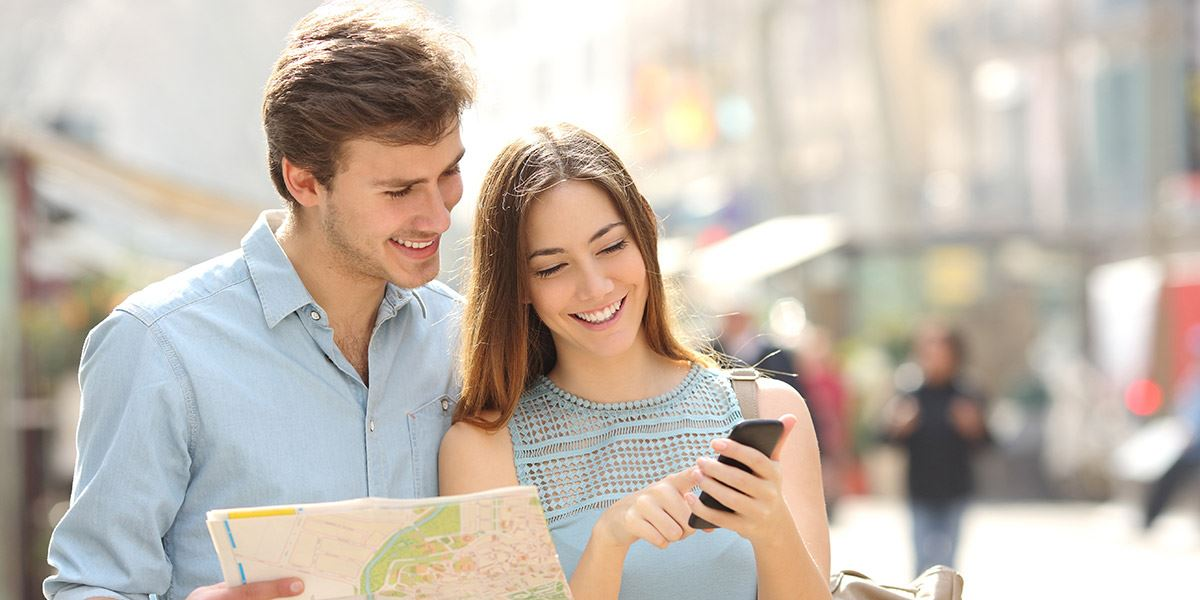 Couple walking with map