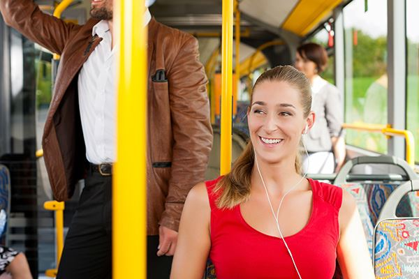 Lady on bus listening to music