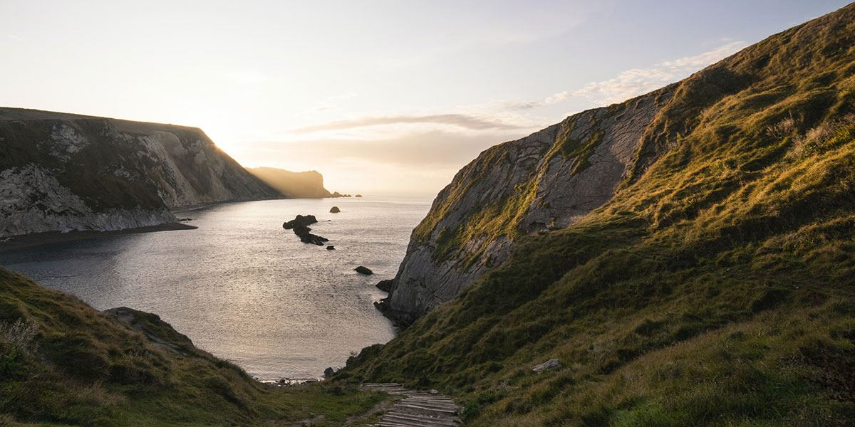 Visit Lulworth Cove and take in the area's beauty