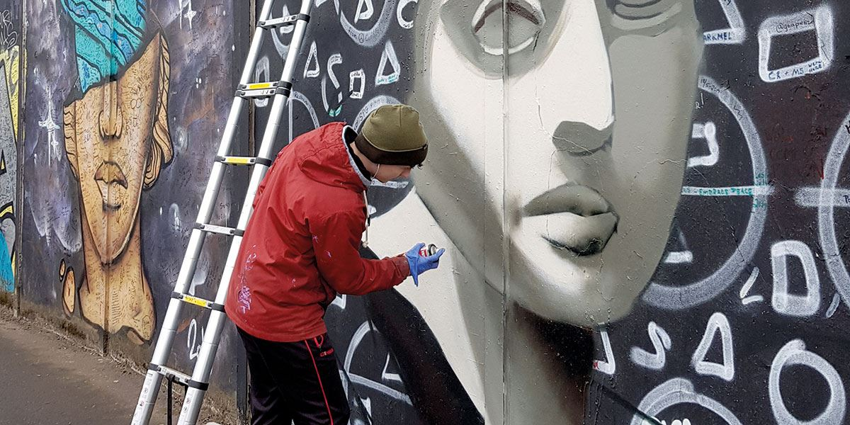 Make sure you don't miss the ever-changing Peace Wall murals