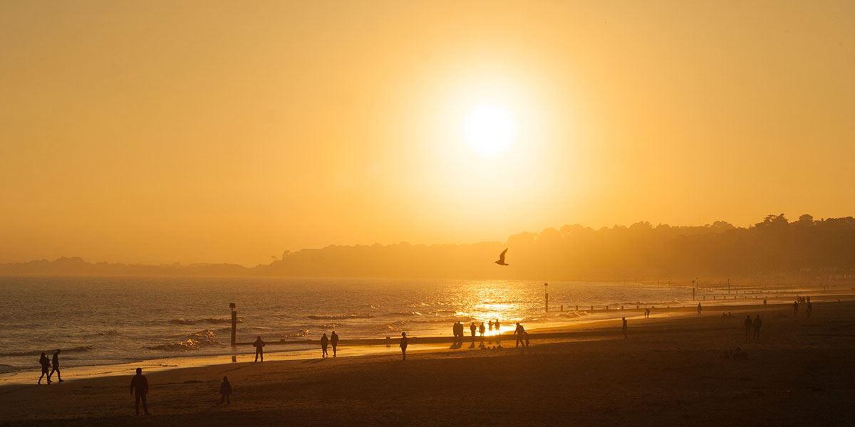 Enjoy a glorious sunset on Bournemouth Beach