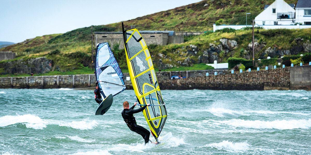 Two windsurfers in sea
