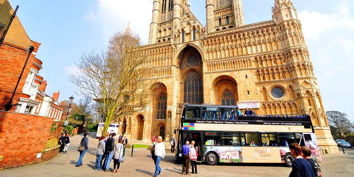 Hop on or off a Lincoln city sightseeing bus