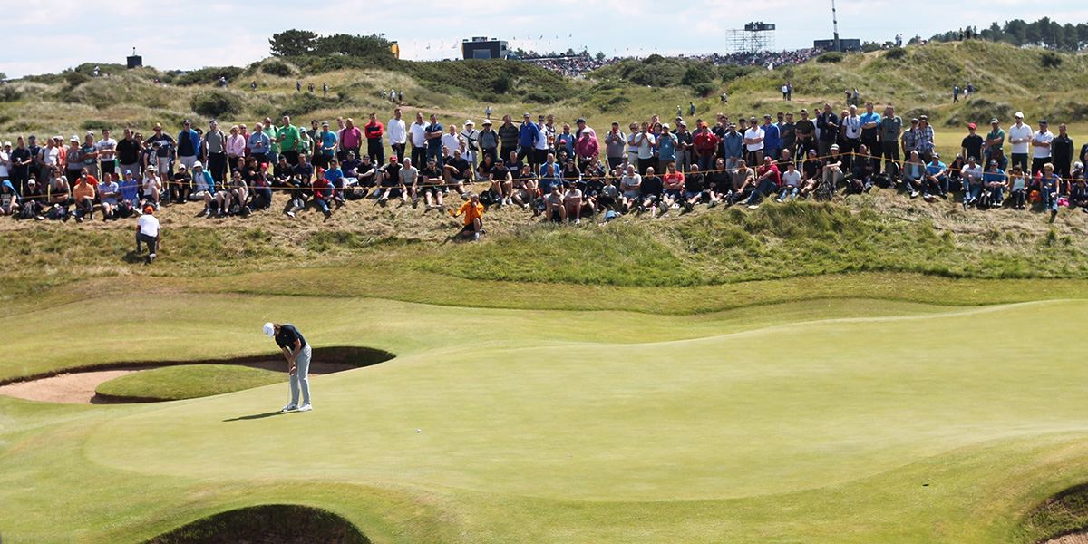 Pro golfer Tommy Fleetwood putting at Royal Birkdale