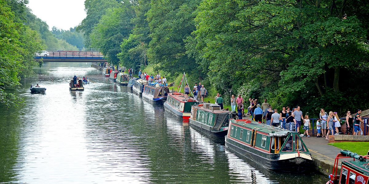 Narrowboats lined up on the River Soar