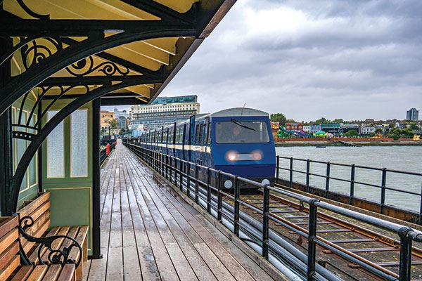 Ride the train along the longest pier in the world