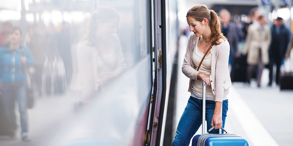 Woman getting onto train Inverness and Loch Ness travel