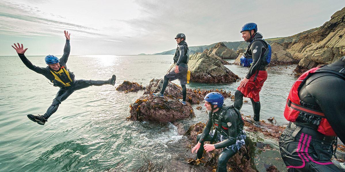 Group of people coasteering