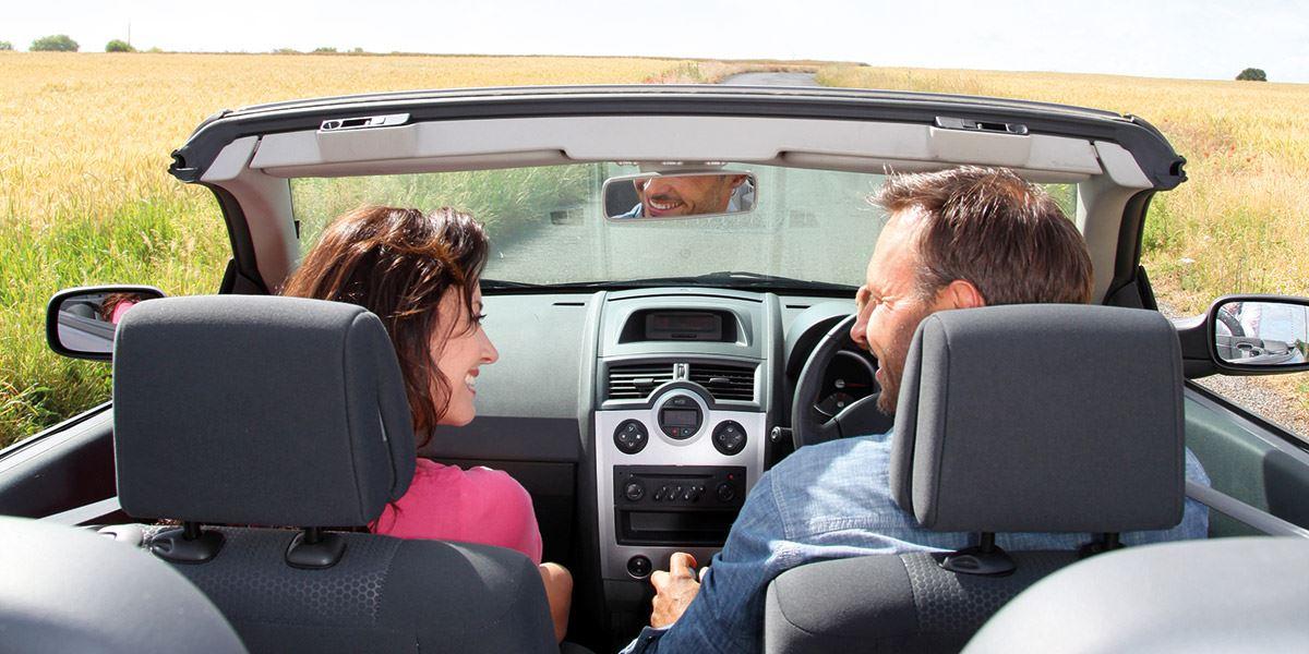 Couple in open-top car