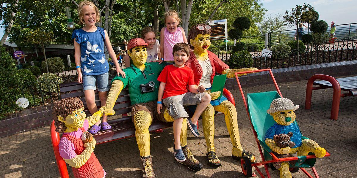 Family with lifesize lego people at Legoland Windsor Resort
