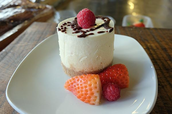Cheesecake with fresh strawberries and raspberries at Foodilic cafe in Brighton