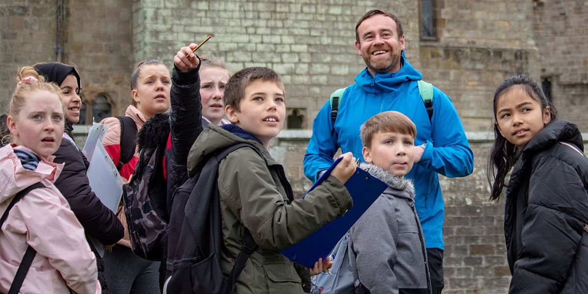 The Big Smile walk leader Kieron Young teaches a class of students about the great outdoors