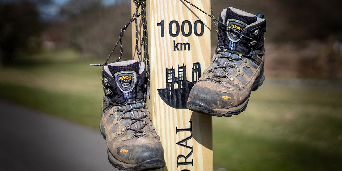 The Big Smile boots on 100km signpost