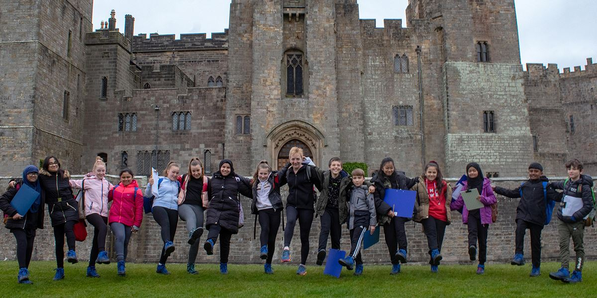 Schoolchildren show off their new boots, courtesy of The Big Smile and the Walk & Talk Trust, at Raby Castle