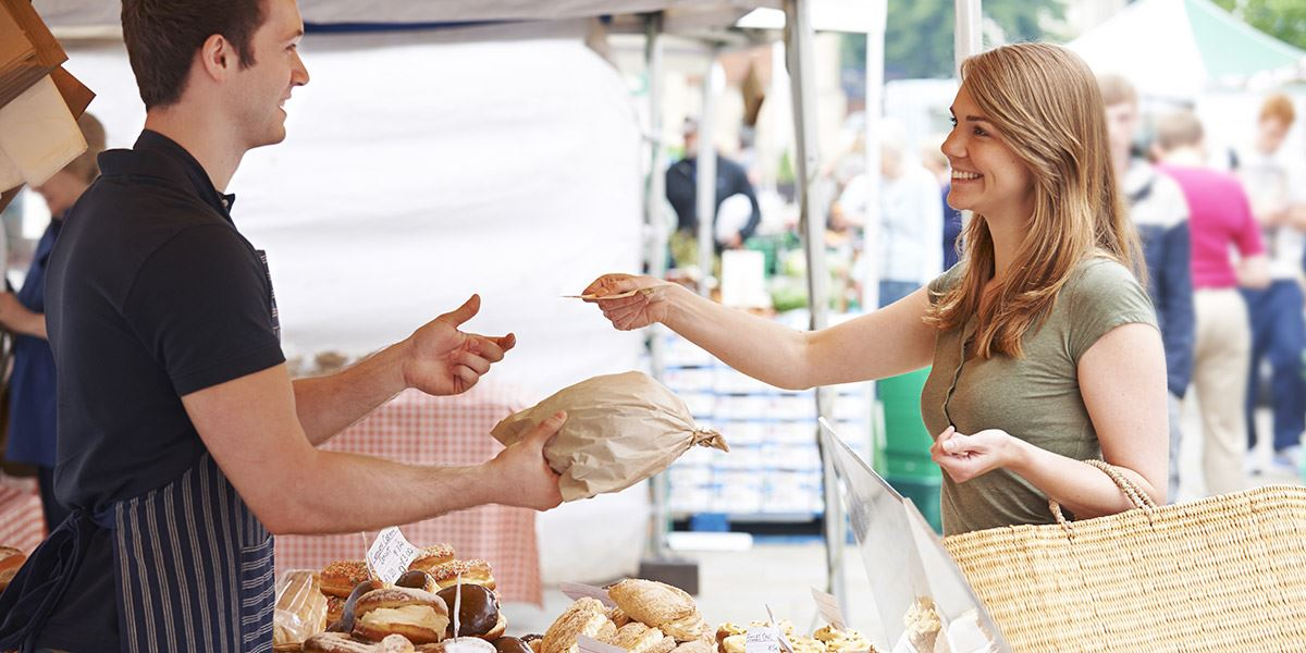 Buying bread at a market stall