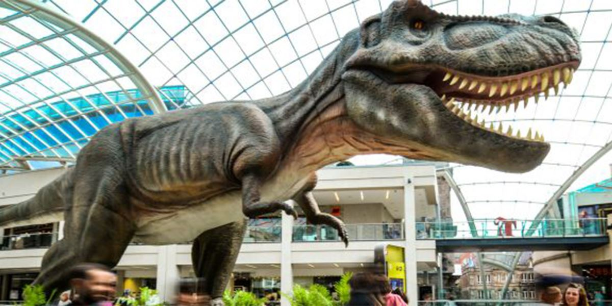 A full-size T-Rex dinosaur model at the Jurassic Trail, which includes The Core