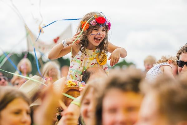Young music fan enjoying herself in the crowd at The Big Feastival festival in Oxfordshire