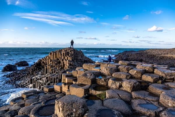 People on the Giant's Causeway in County Antrim, Northern Ireland