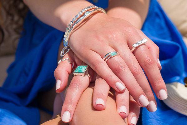 Female models holding hands wearing Silver Origins rings and bracelets