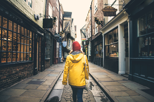 Woman walking down The Shambles in York