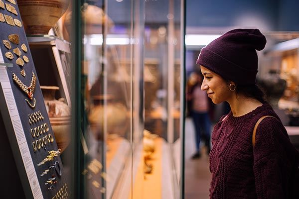 Woman looking at an exhibition in the British Museum, London