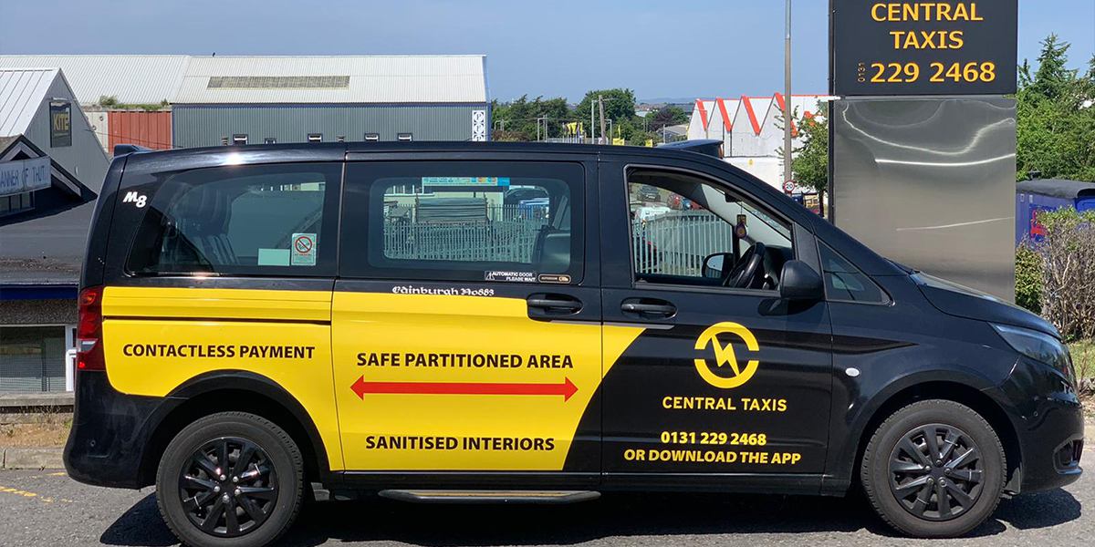 Central Taxis vehicle showing Covid-safe statements