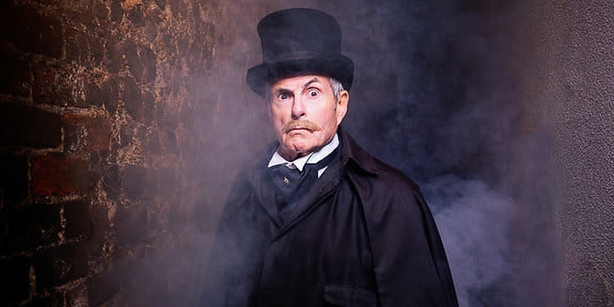 A tour guide for Ghost Walk of the Lanes, Brighton emerges from the mists