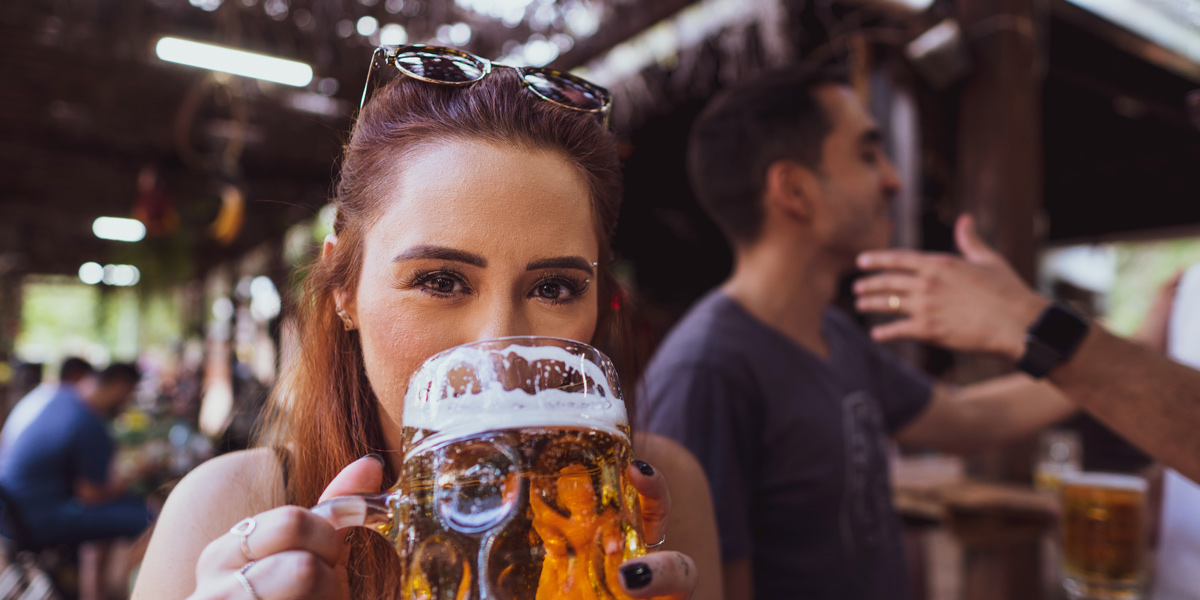 Woman drinking a beer out of an stein