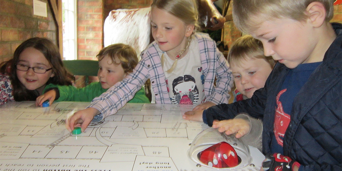 Children playing a board game at The World of James Herriot