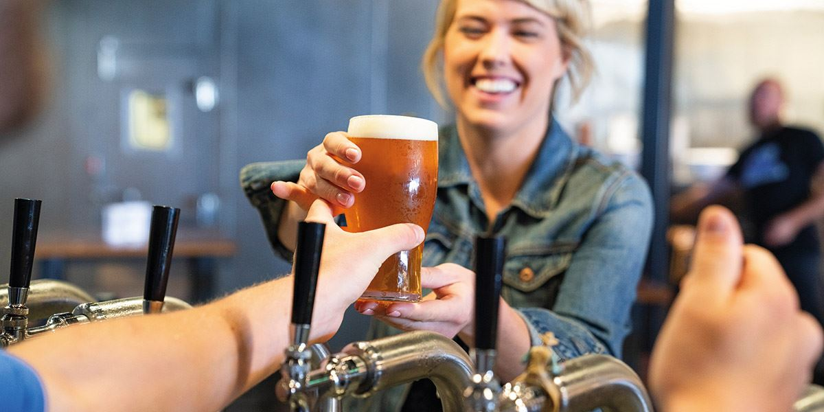 Woman serving pint